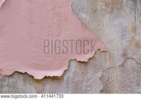 Peeling Dried Pink Paint On A Cement Concrete Old Wall