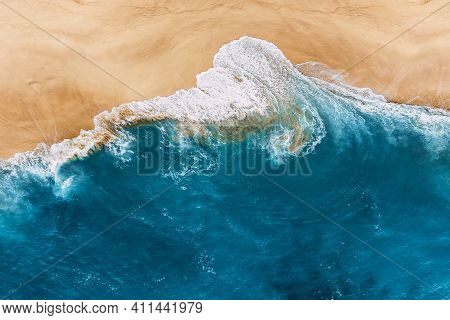 Blue Ocean And Clean Sandy Beach. Beautiful Sea And Wild Beach With Yellow Sand. Blue Ocean Wave On