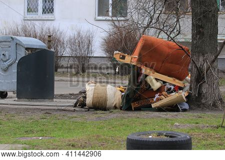Environmental Pollution. Garbage Dump On The Grass Near A Multi-storey Building In A Big City, Pollu