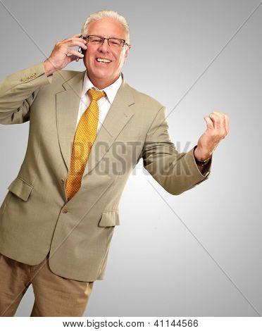 Senior Business Man Talking On Phone Isolated On gray Background