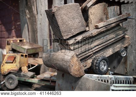 Children's Toy Made Of Wood In The Shape Of A Car, Made Of Wood. Rural Farm, Soft Focus
