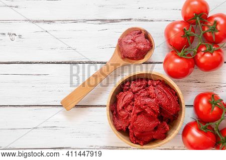 Traditional Turkish Tomato Paste In Bowl Or Spoon With Fresh Tomatoes On Wooden Table, Homemade Heal