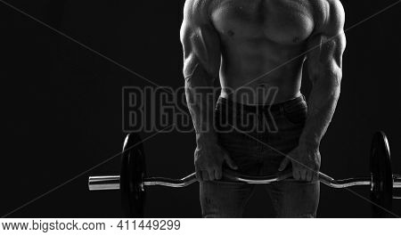 Silhouette Of Brutal Strong Man Athlete In Jeans Doing Workout Lifting Bar Weight Showing Pumped Up