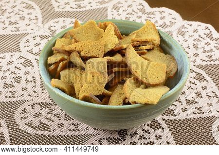 Rye Wheat Bread Bite Snack In A Ceramic Snack Bowl On Lace