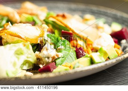 Clay Plate With Vegetable Salad Of Caramelized Pear, Beetroot, Arugula, Avocado, Carrot And Dorblu C