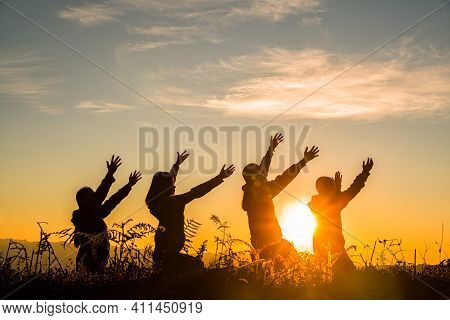 Four Girl Bowed And Prayed At Sunset In The Mountains