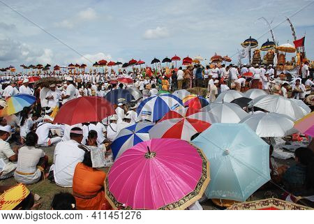 Gianyar, Bali 9 June 2014: Balinese Hinduism village people got together to depart to the beach for