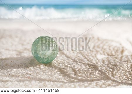 sea glass marbles  with white sand beach  seascape