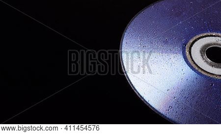 Cd Disk In The Rain. Cd Drive Trash. Cd Disc. Compact Disc Isolated On Black Background.