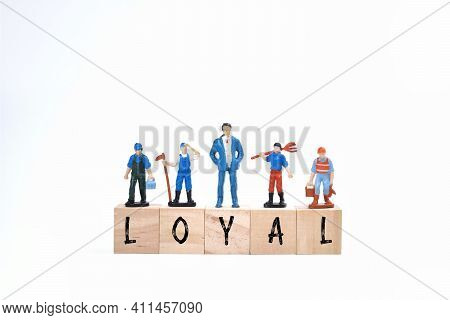 Selective Focus Image Of Miniature People With Loyal Wording On A White Background. Conceptual Image