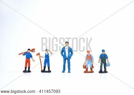 Selective Focus Image Of Miniature Of Rich People And Poor People On White Background. Conceptual Im