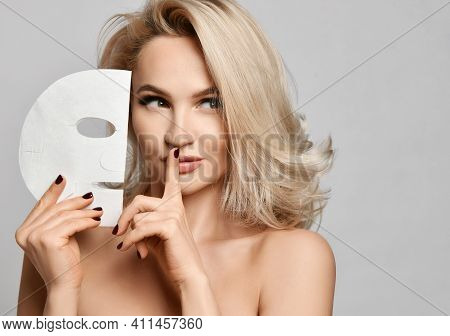 Portrait Of Naked Gorgeous Blonde Woman With Healthy Silky Skin Holding Textile Facial Care Masks Ge