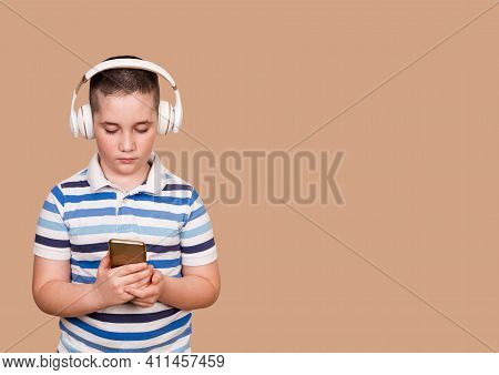 Happy Little Child Listening Music With Headphones. Cheerful Young Boy Listening To The Music In Hea