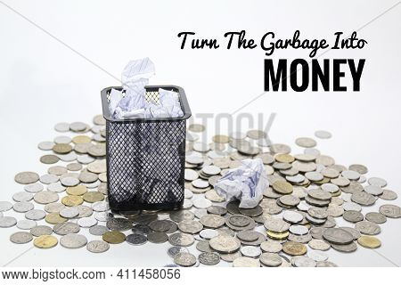 The Concept Of Turning Rubbish Into Money With Rubbish Bins Surrounded By Coins.