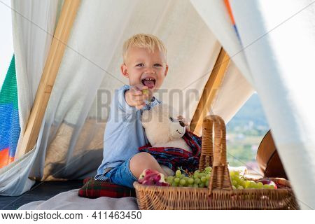 Happy Kid In Tent. Boy Playing In Tent. Kids Camping. Having Fun Outdoors. Campground. Funny Face Cl