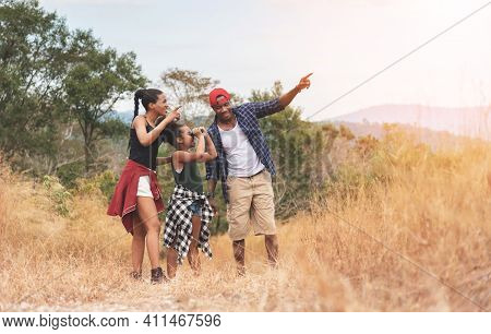 African-american Father, Mother And Girl Daughter Using Binocular While Trekking On Mountain At Outs
