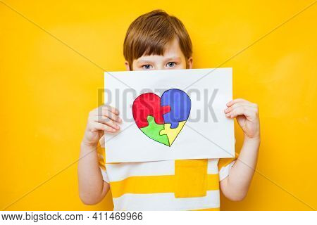 Kid Boy Hands Holding Puzzle Heart, Child Mental Health Concept, World Autism Awareness Day, Teen Au