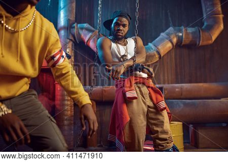 Rappers poses, break-dance performing in studio