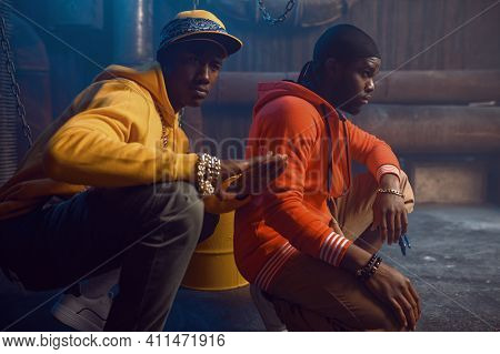 Two stylish rappers poses in studio