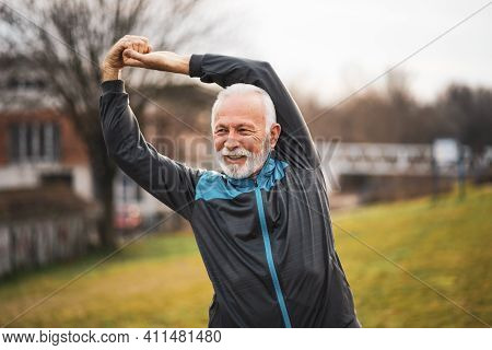 Active Senior Man Is Exercising. Healthy Retirement Lifestyle.