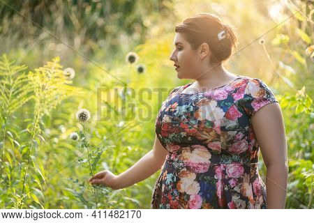 Plus Size Model In Floral Dress Outdoors, Beautiful Fat Woman With Big Breasts In Nature