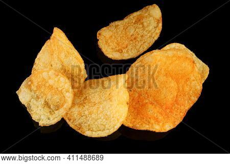 Potato Chips Snacks And Crunchy Food On A Black Background