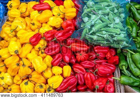Different Kind Of Peppers For Sale At A Market