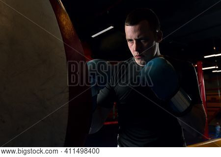 Sporty Male Boxer With A Confident Look. Photo Of A Boxer In The Ring. Strength And Motivation. High