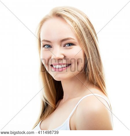 Happy young attractive blond woman with beautiful smile and healthy teeth, over white background. Dental health, whitening, prosthetics and care