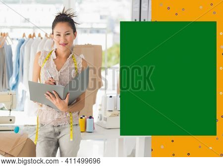 Portrait of smiling asian female fashion designer at work with yellow and green copy space on right. creative businesswoman concept, digitally generated image.
