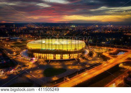 Gdansk, Poland - 19 October, 2020: Aerial landscape with amber shape Energa Stadium in Gdansk at dusk, Poland.
