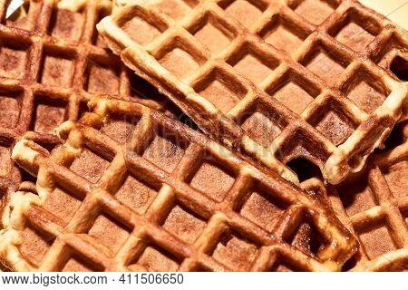 Close Up Shot Of Freshly Baked Belgian Waffles, Traditional Belgian Dessert. Sweet Food, Unhealthy E