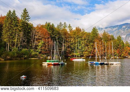 Slovenia. Sailing yachts and motor boats. Magnificent lake with clear water is surrounded by dense forests. Bohinj is an alpine lake in the Julian Alps