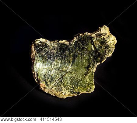 Shiny Green Muscovite Mica Mineral Sheet Isolated On Black. Found In Miass, Ural, Russia. For Geolog