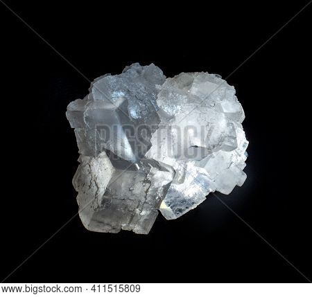 Shiny Transparent Halite Rock Salt Mineral Crystal From Soligorsk, Belarus. A Photo Isolated On Blac