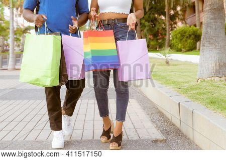Midsection Of Couple With Shopping Bags In City. Two Friends Shopping Together Walking For The Stree