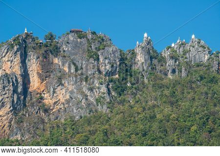 Group Of Floating Pagodas On Mountain Peak In Temple Of Wat Chaloem Phra Kiat, One Of The Most Touri