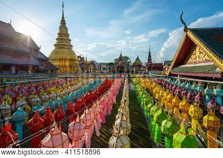Wat Phra That Hariphunchai With Traditional Paper Lanterns Hanging On The Rows During Yi Peng (or Ye