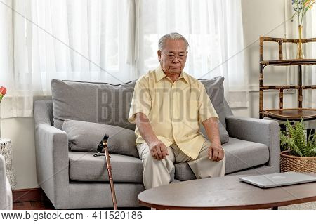 Lonely Asian Senior Man Was Sick And At Home Alone. Retirement Age Lifestyle