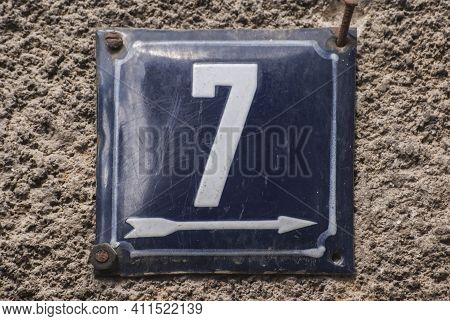 Weathered Grunge Square Metal Enamelled Plate Of Number Of Street Address With Number 7