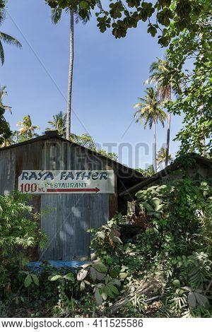 Thailand, Raya Island, December 31, 2019: Racha. A Sign For A Restaurant On An Old Barn In The Middl