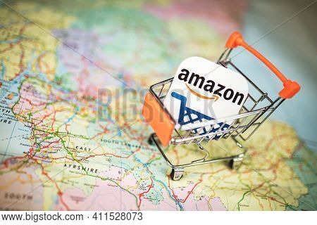 Amazon Logo In A Small Shopping Trolley Over Uk Map. Online Shopping, Amazon Purchase, E-commerce Co