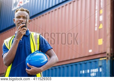 Adult African American Men Worker Check And Control Loading Freight Containers By Use Radio At Comme