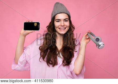 Photo Of Beautiful Positive Smiling Young Woman Wearing Stylish Casual Outfit Isolated On Colorful B