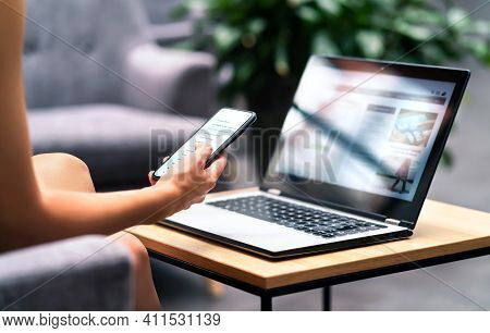 Wireless Wifi For Remote Work In Airport Lounge Bar, Hotel Lobby Or Cafe. Phone And Laptop. Woman Us