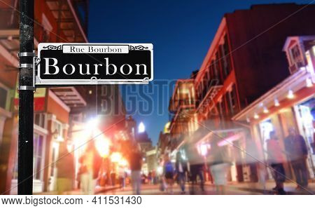 Tourists Walk Along Bourbon St In New Orleans French Quarter At Night