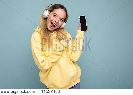 Beautiful Happy Smiling Young Woman Wearing Stylish Casual Outfit Isolated On Background Wall Holdin
