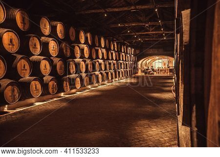 Porto, Portugal: Historical Winery Sandeman, With Wooden Barrel, It Making Porto Wine From 18th Cent