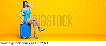 Woman Light Summer Skirt Sit On Suitcase Wheels.female Legs Pastel Wall Background.woman Studio Phot