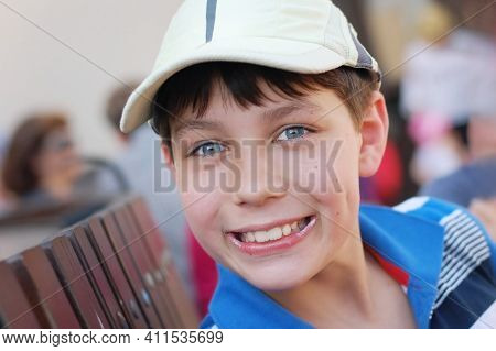 The Boy Enjoys Eating Ice Cream In The Summer. On His Lips He Has Left An Ice Cream. He Is Happy And